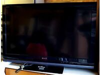 "SONY BRAVIA HD 40"" TV. AND TOSHIBA DVD PLAYER."
