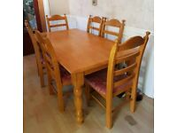 Solid wooden dining table and 8 chairs