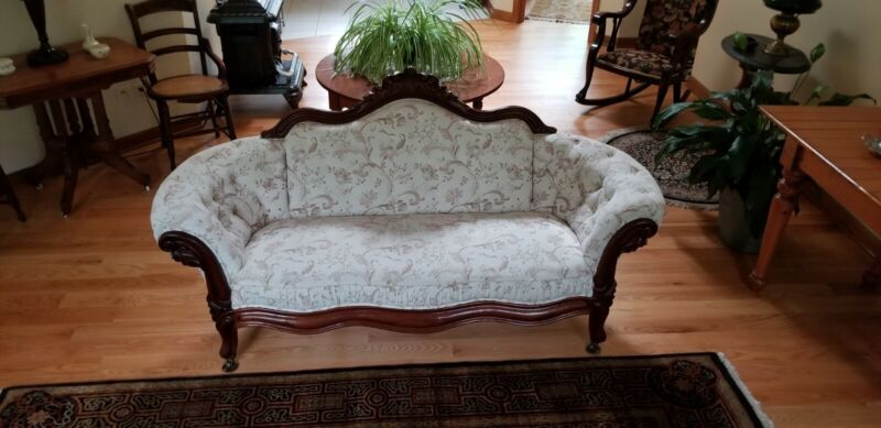 Ornately Carved Walnut Victorian Loveseat w/tufted arms and back