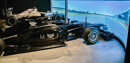Full size replica f1 simulator x 2