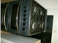 Black Gas Cooker good condition with glass fold down lid with gas connection pipe