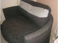 Medium round, grey swivel cuddle chair. For Sale.