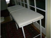 massage bed portable in colour white