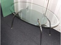 oval glass table with smaller glass shelf 5ft x 3ft