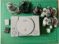 PlayStation 1 with 30+ games and 2 controllers