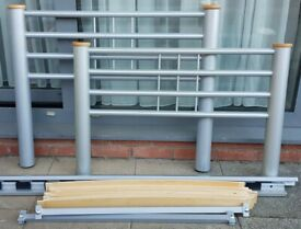 single-size metal bed frame with sprung wooden slats. In used but good condition.