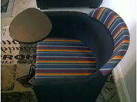 A New Charcoal Tub Chair with Rainbow patterned seat and head rest