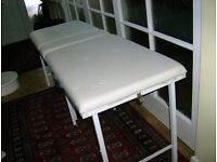 Massage Bed in good condition folding type easily transportable in colour white