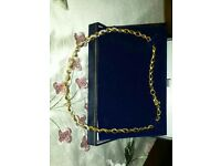 Rope style diamond and gold necklace.