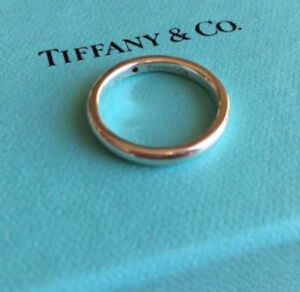 As new ~ authentic Tiffany & co diamond ring