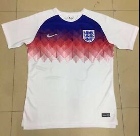 England tops home and away small to xL