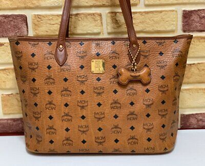 100% Authentic MCM Cognac Visetos Shopper Shoulder Bag with Dogbone Keycharm