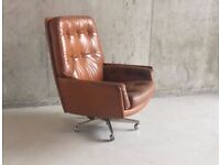 1960/70's Danish mid century brown leather armchair on swivel base with castors