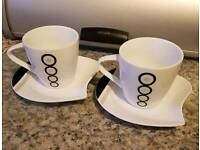 Two cup and saucers.
