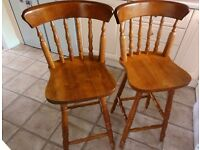 Wooden bar stools/chairs with backs, dark pine colour.