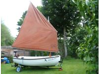 Small sailing boat. Swallows and Amazons type with Lug rigged sails. Very stable.