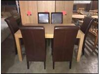 Table and 6 brown chairs in above average condition