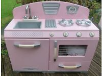 Pink toy kitchen - sink unit and cupboard, includes variety of accessories