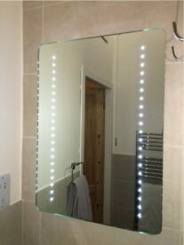 LED mirror with demister and sensor switch.