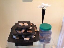Internal water feature including spare pebbles