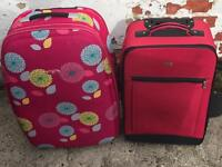 Two suitcases medium sized