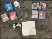 PS4 console + seagate 2TB memory + 7 games