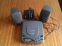 Old skool cd player, with speakers. Works.