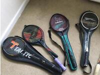 Four badminton rackets with cases and shuttlecocks