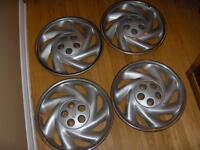 5 CHEVY HUBCAPS, FITS CAVALIER.