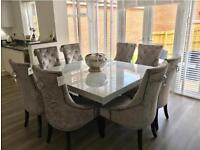 Barker and Stonehouse solid marble dining table with crushed velvet chairs.