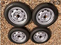 Four wheels with almost new Toyo tyres