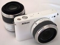White Nikkon Camera.Absolute Bargain. Would make a great Xmas gift.