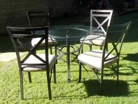 Glass Dining Table and Four upholstered chairs