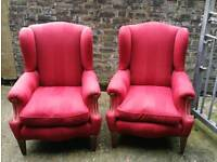 A pair of wingback armchairs not Chesterfield.
