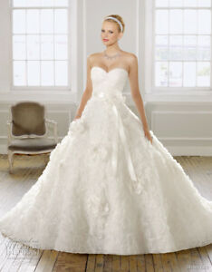 Never worn gorgeous wedding gown from Mori Lee bridal