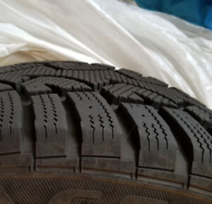 Tires and rim for sale.