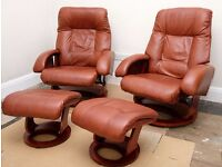 Two brown leather swivel recliner chairs and matching footstools