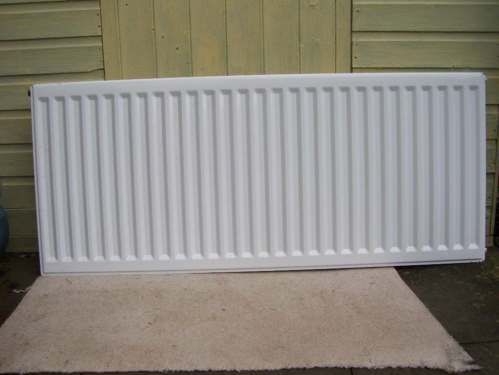 Type 11 Single Radiator, White. 600mm High, 1400mm Long. Side/top covers. 2 off wall brackets,