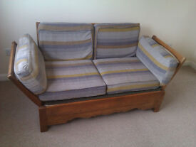 c.1950's parker knoll sofa with fold down side arms