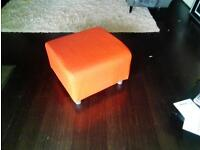 attractive orange seat/foot stool