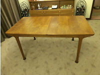McIntosh teak extending dining table with 8 chairs