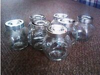 SEVEN VERSATILE CUTE LITTLE SOLID THICK GLASS JARS WITH SILVER LIDS ON