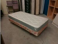 Single bed on legs and casters. Vintage. Clean good mattress