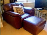 Very comfortable dark brown leather armchair and matching stool