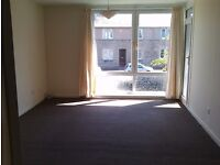 Large 2 bed unfurnished flat. Central. On bus route. Available immediately.