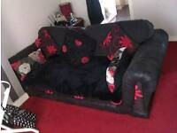3 seater sofa with throw and scatter cushions