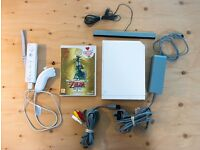 Nintendo Wii Console bundle w/ Zelda Skyward Sword (includes Wii Remote Plus and Nunchuck)