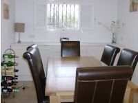 Oak Dining room table and 6 real leather chairs