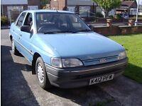 ford escort 1.4L 5 door hatchback.