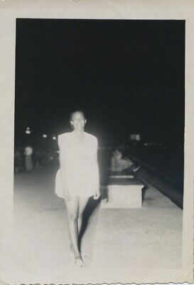 Vintage photo. PRETTY AFRICAN-AMERICAN WOMAN ON NIGHT STREET.